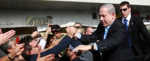 Israel's Prime Minister Benjamin Netanyahu seen shaking hands with Israeli citizens during a visit to the southern city of Ashdod, as Israelis go to vote in Israeli general elections for Israel's 19th parliament. January 22, 2013. Photo by Yossi Zamir/Flash90