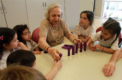 "Lucrecia, a three-year resident of the LeDor VaDor senior complex in Buenos Aires, Argentina, garners strength from the weekly intergenerational activities with ""her kids"" at JDC's Baby Help nursery and day care."