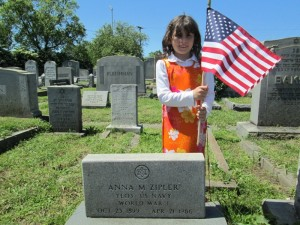 Zipporah Goldberg placing flags at the graves of Jewish Veterans at the B'nai Israel Cemetery.