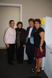 JFS Knitters Club members Leslie Legum, Natalie Steiner and Sandy Mendelsohn pose with JFS volunteer coordinator Jody Laibstain and the donated freezer.