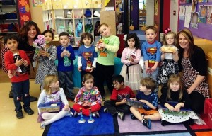 Strelitz preschool four-year-olds show off their Shabbat dinner donations, along with teacher Elyssa Brinn and assistant Jacquie Lam.