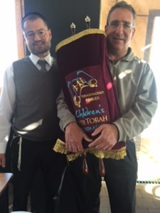Kevin Lefcoe holds the Sefer Torah.