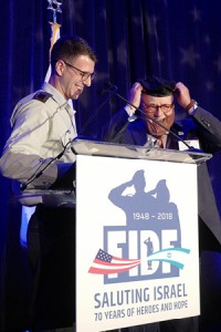 FIDF IMPACT! student Roi gives his beret to his IMPACT scholarship donor Avraham Ashkenazi.