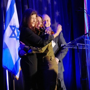 Virginia native and Lone Soldier Ilana surprises her parents, Marcy and Michael Mostofsky, on stage during the FIDF Virginia Inaugural Gala.