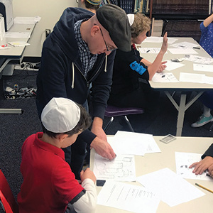 HAT 4th and 5th graders in Hebrew Caligraphy workshop with artist, Hillel Smith.