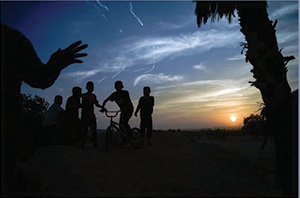 Photo by Annie Sandler Arab Israeli youth play at sunset in a Bedouin village.