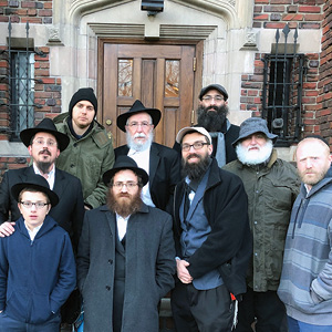 In front of 770, Lubavitch World Headquarters: Top row: Ross Kravtsov, Boruch Levy, Jason Silverstein; middle row: Rabbi Levi Brashevitzky, Rabbi Zalman Margolin, Yehoshua Weinstein, Don Hornstein, Max Siegel; front row: Shalom Brashevitzky.