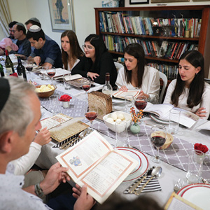 A family participates in the Passover seder.