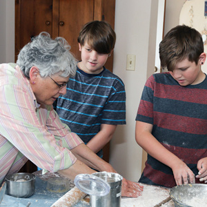 Sheryl Luebke and twins John and Peyton Rchardsonprepare the dough for Hamantashen.