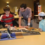 Third graders, Effie Blair and Ben Amitay, who shows his bridge project to Science Fair judge.