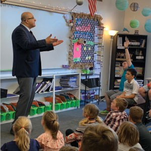 Ambassador Ido Aharoni sharing details of what it's like to be an Ambassador with Henry Scolnick and his fourth grade class at Cape Henry Collegiate.