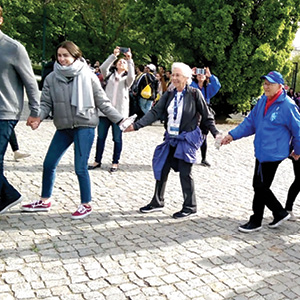 Singing and dancing with survivors, Warsaw Memorial.
