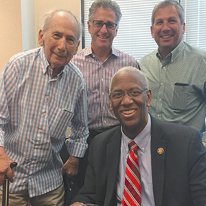 Arnold Leon, Kirk Levy, and Miles Leon with  Congressman Donald McEachin.
