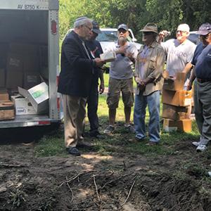 Rabbi Michael Panitz and members of Temple Israel at Mikro Kodesh Cemetery.
