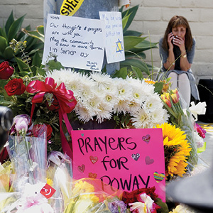 Huffaker/AFP/Getty Images A makeshift memorial sits across the street from the Chabad of Poway Synagogue, April 28, 2019, one day after a gunman killed one person and injured three others.