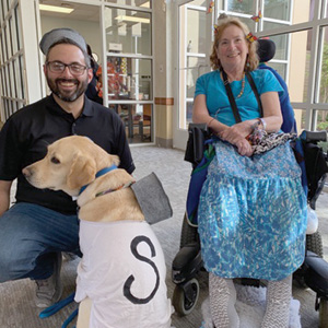 Director of Recreational Therapy Josh Bennett, service dog Yanni, and Pat Jankosky.